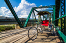 Tricycle on a Wooden Bridge